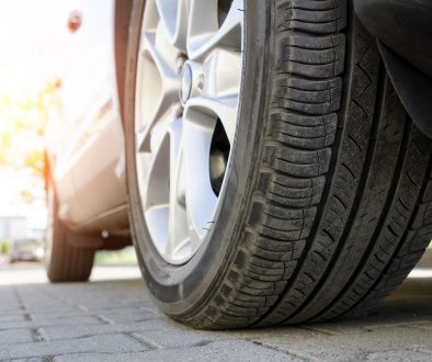 Car tire close up, parked car low angle shot